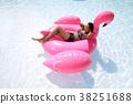 Relaxing in swimming pool 38251688