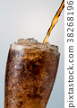 Soft drink pouring to glass with crushed ice cubes 38268196