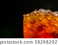 Soft drink with crushed ice cubes in glass  38268202