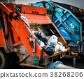 Back of old garbage truck with waste.  38268206
