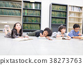 Happy kids and bored kids reading on the floor. 38273763