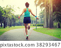 woman runner athlete jumping rope at tropical park 38293467