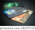Three colored credit cards isolated on black 38297539