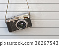 Vintage retro photo camera hanging on the white 38297543