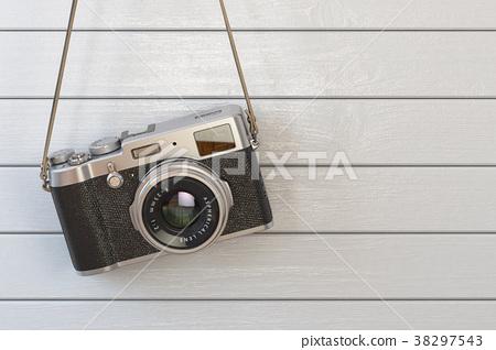 Vintage retro photo camera hanging on the white 38297543
