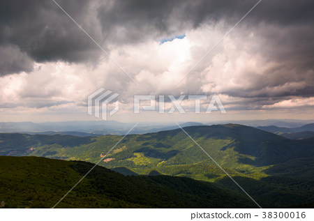 gorgeous cloudy sky over the mountains 38300016