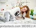 Ten years girl sitting with bunny 38300114