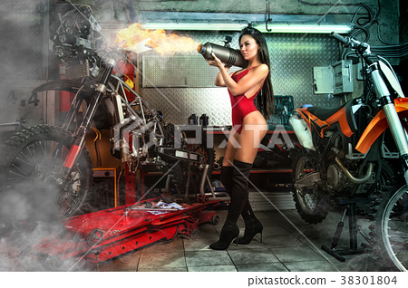 Sexy girl in garage with motorcycles 38301804
