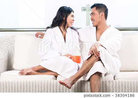 Couple in morning sitting on couch 38304186