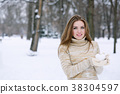 Woman holding a snowball 38304597