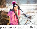 Fit woman Nordic walking in winter landscape 38304643