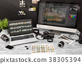 Photographers computer with photo edit programs. 38305394
