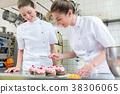 Two baker women in pastry bakery working on 38306065