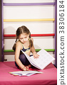 Little caucasian 6-8 years old girl doing one's 38306184