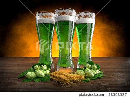 three glasses of green beer with barley and hops 38308327