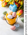 Easter composition with quail eggs and tulips 38308395