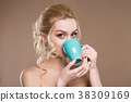 Girl with a cup in his hands 38309169