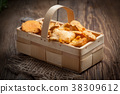 Freshly harvested mushrooms in the forest. 38309612