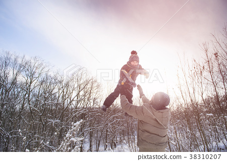 Father catch son on sky winter background 38310207