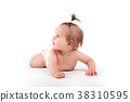 cute baby girl lies in diapers 38310595