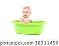 little cute baby boy take bath in green tub 38311450