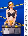 Attractive sexy builder girl in black bikini 38315487