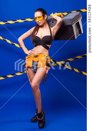 Attractive sexy builder girl in black bikini 38315488