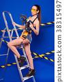 Young sexy builder girl in black bikini, denim 38315497