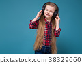 Cute girl in shirt and earphones with long hair  38329660