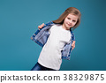 Little beauty girl in jean jacket with long brown 38329875