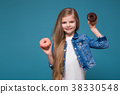 Little pretty girl in jean jacket with long brown 38330548