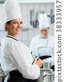 Female chefs at work in system catering 38333957