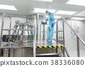 scientist look in steel tank in laboratory 38336080