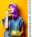 Young girl with purple hair with vintage telephone 38339104