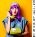 Young girl with purple hair with vintage telephone 38339106