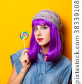 Young girl with purple hair and lollipop 38339108