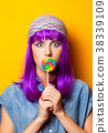 Young girl with purple hair and lollipop 38339109