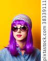 Young girl with purple hair and sunglasses 38339111