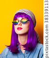Young girl with purple hair and rainbow on suglasses 38339113
