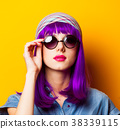 Young girl with purple hair and sunglasses 38339115