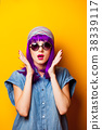 Young girl with purple hair and sunglasses 38339117