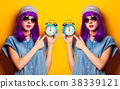Young girl with purple hair and alarm clock 38339121