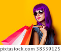 Young girl with purple hair and shopping bags 38339125