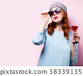 girl with glass of drink 38339135