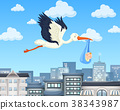 Crane flying over the city with baby boy 38343987