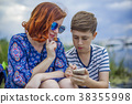 Mother with son and smartphone 38355998