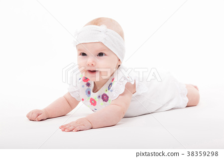Baby girl on a white background in a smart dress 38359298