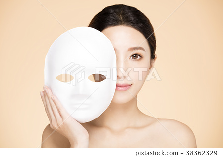 Young woman face with facial mask concept 38362329