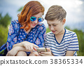 Mother with son and smartphone 38365334