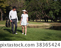 Asian young couple playing golf on golf course 38365424